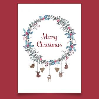 Pocztówka świąteczna z wieńcem z liści i drewnianymi zabawkami