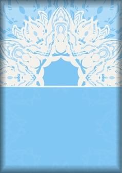 Pocztówka w kolorze niebieskim z mandalą w białym zdobnictwie gotowa do nadruku.