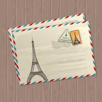 Pocztówka w stylu vintage z wieżą eiffla, znakami i znaczkami francji