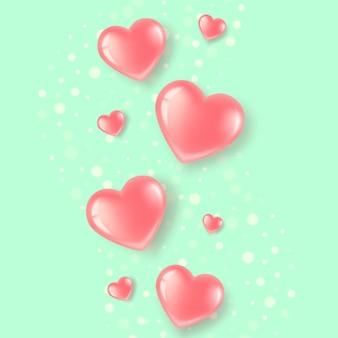 Pocztówka z różowymi sercami na zielonym jasnym tle.