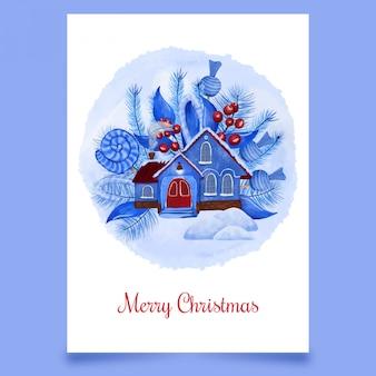 Pocztówki świąteczne z niebieskim domu pokryte śniegiem