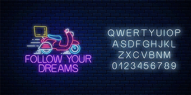 Podążaj za marzeniami - świecący neonowy napis ze skuterem na ciemnym tle ceglanego muru z alfabetem.