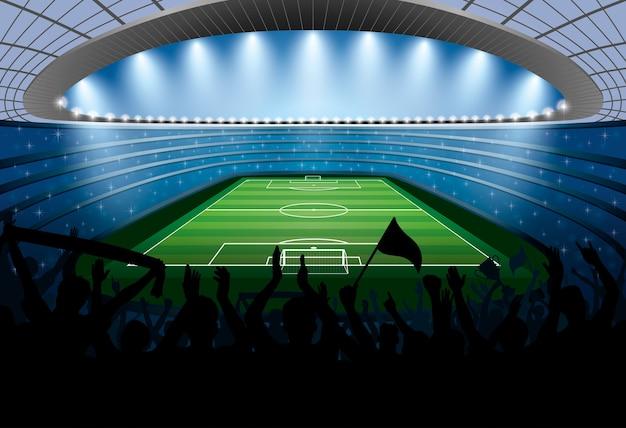 Podekscytowany tłum ludzi na stadionie piłkarskim