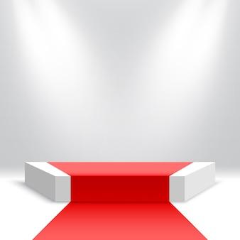 Podium z czerwonym dywanem pusty cokół z reflektorami platforma ekspozycyjna produktów scena