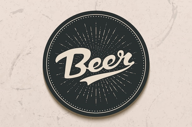 Podkładka do piwa z ręcznie rysowane napis piwo. monochromatyczny rysunek vintage do motywów barów, pubów i piwa. czarne kółko do umieszczenia na nim kufla lub butelki z napisem. ilustracja