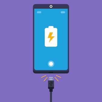 Podłącz przewód ładowarki zgodnie z ilustracją przedstawiającą telefon komórkowy.
