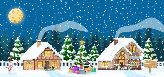 Podmiejskie domy pokryte śniegiem. budynek w świątecznym ornamentie. choinka krajobraz świerk, bałwan. dekoracja szczęśliwego nowego roku. wesołych świąt bożego narodzenia. boże narodzenie nowego roku. ilustracja