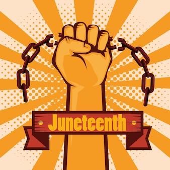 Podniesiona dłoń trzymająca łańcuch i znak juneteenth