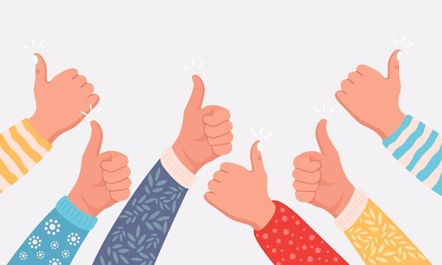 Podniesione ludzkie ręce z kciukami do góry.