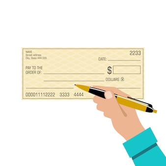 Podpisanie czeku bankowego. pióro w dłoni