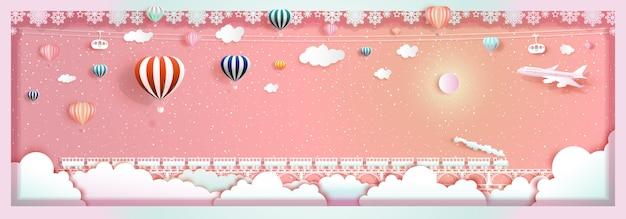 Podróż szczęśliwego nowego roku i świąt bożego narodzenia z balonami