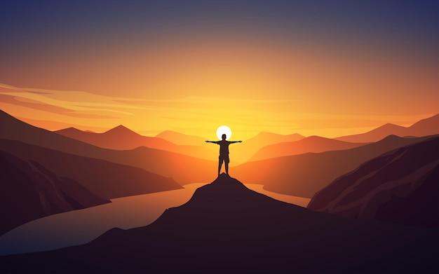 Podróżnik stojący na skraju klifu o zachodzie słońca