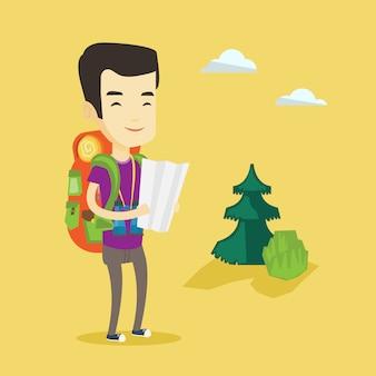 Podróżnik z plecakiem, patrząc na mapę.