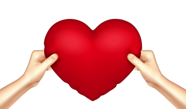 Poduszka w kształcie serca w ręce realistyczne