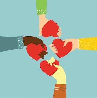 Podziel się swoją miłością. ręce z sercami jak masaże miłosne.