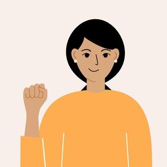 Pojęcie kobiecej władzy a międzynarodowy ruch feministyczny. kobieta z uniesioną pięścią.