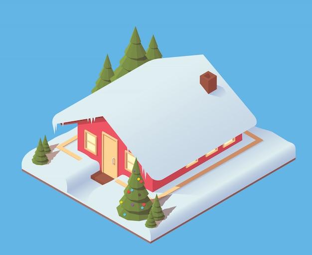 Pokryty śniegiem dom z choinką.