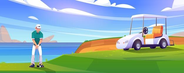 Pole golfowe na brzegu jeziora z człowiekiem i wózkiem