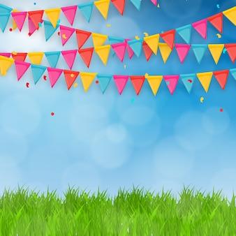 Pole zielona trawa i tło błękitnego nieba z flagi wakacje.