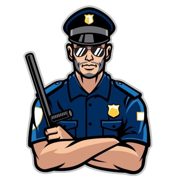 Policjant pozuje w skrzyżowaniu broni