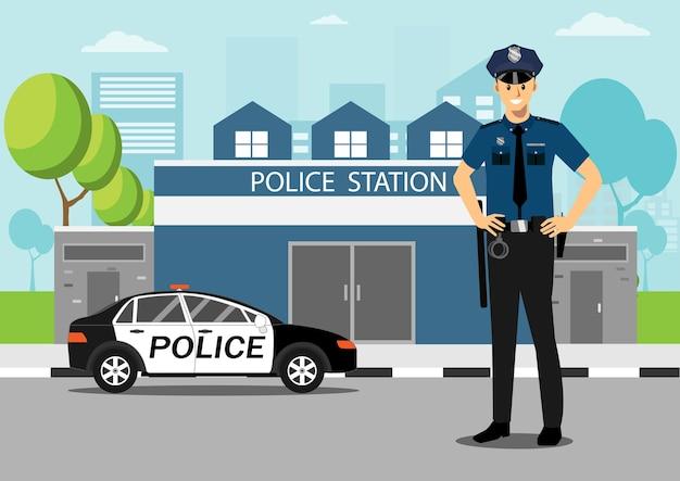 Policjant z samochodem policyjnym przed komisariatem policji.