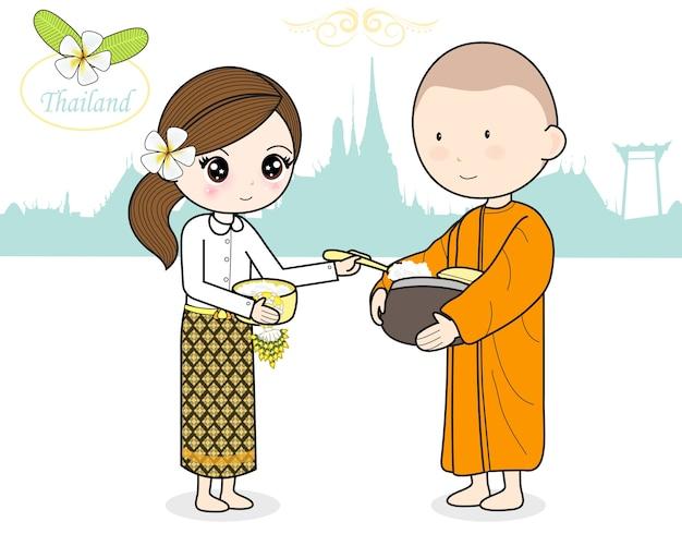 Położyć ofiarę żywnościową w miskę datku buddyjskiego mnicha