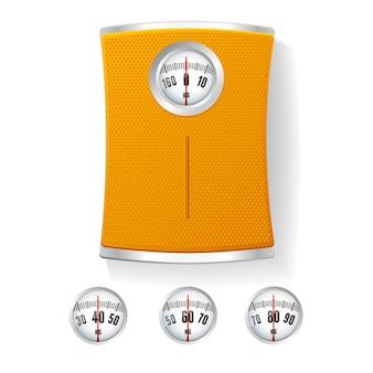 Pomarańczowa waga łazienkowa z różnymi tarczami.