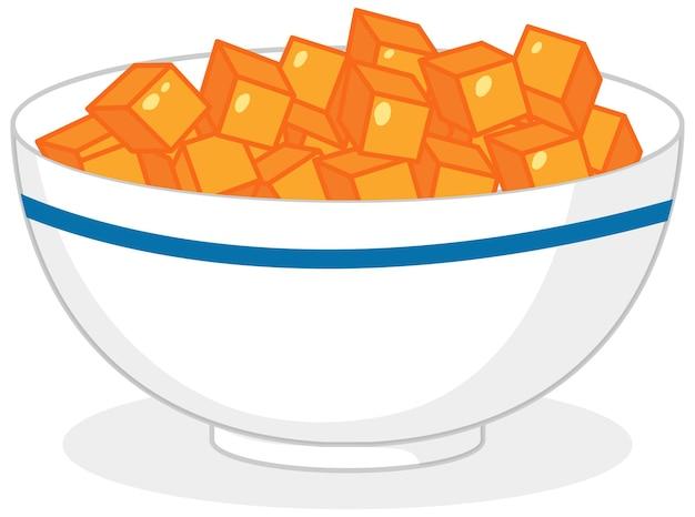 Pomarańczowe kostki cukierków w misce na białym tle