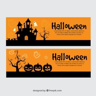 Pomarańczowe transparenty z czarnym halloween sylwetki