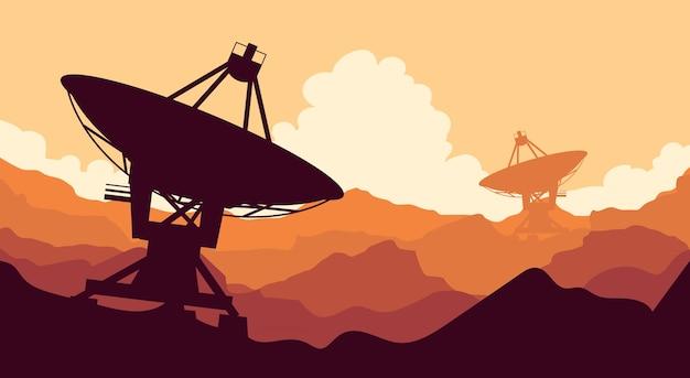 Pomarańczowy krajobraz z gigantycznymi antenami satelitarnymi