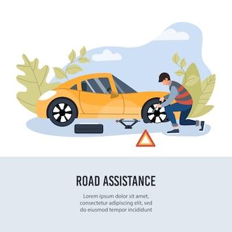 Pomoc drogowa. mechanik zmienia koło na poboczu sztandaru