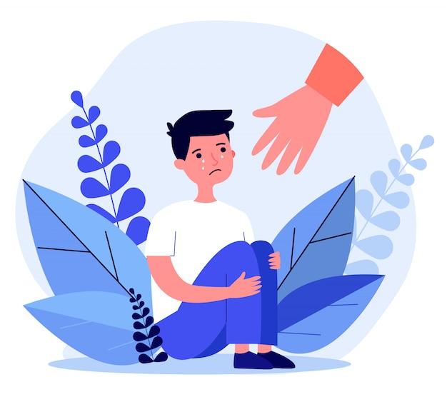Pomocna dłoń dla płaczącego chłopca