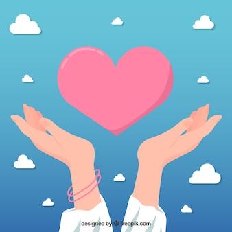 Pomocna dłoń z sercem tło w stylu płaski