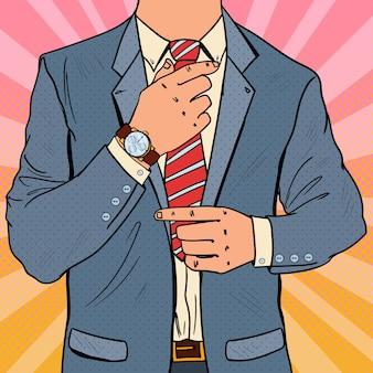 Pop art biznesmen, dostosowując krawat