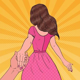 Pop art brunetka kobieta trzymając się za ręce. koncepcja follow me journey.