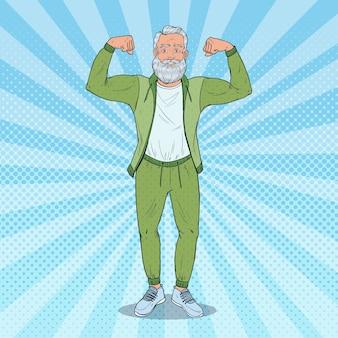 Pop art dojrzały starszy mężczyzna pokazuje mięśnie. szczęśliwy mocny dziadek. zdrowy tryb życia.