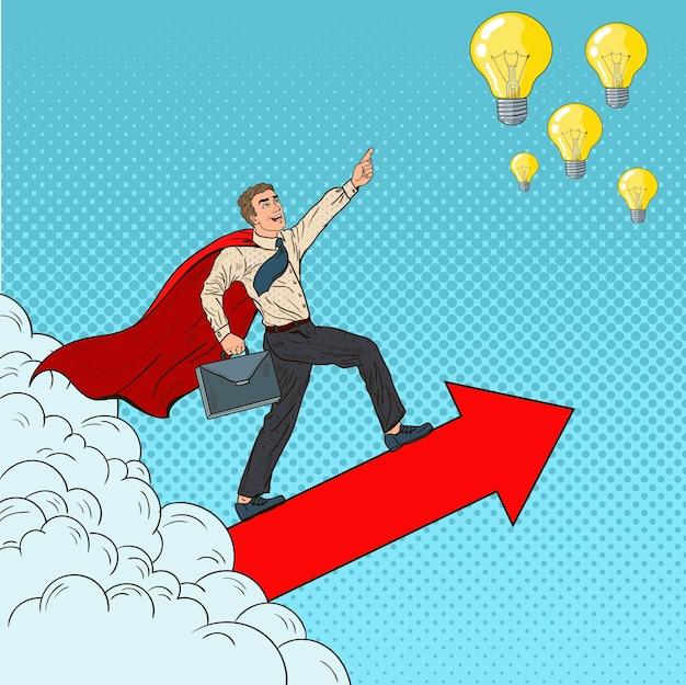 Pop art hero super biznesmen lecący przez chmury do pomysłów. przywództwo w zakresie motywacji biznesowej.