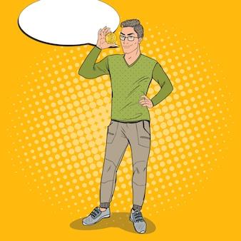 Pop art inteligentny facet trzymający złote bitcoiny
