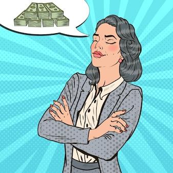 Pop art kobieta sukcesu w biznesie marzy o pieniądzach.