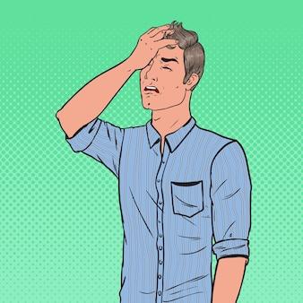 Pop art niezadowolony mężczyzna zakrywający twarz ręką