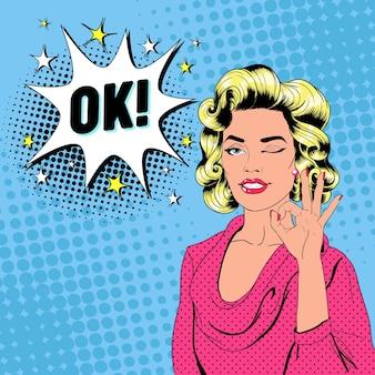 Pop art piękna kobieta mrugając i pokazując znak ok. radosna dziewczyna vintage plakat z komiksową dymek. przypnij baner reklamowy na afisz.