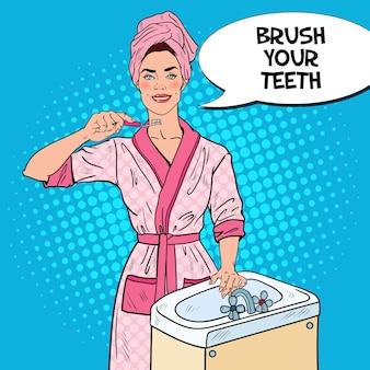 Pop art piękna kobieta szczotkuje zęby