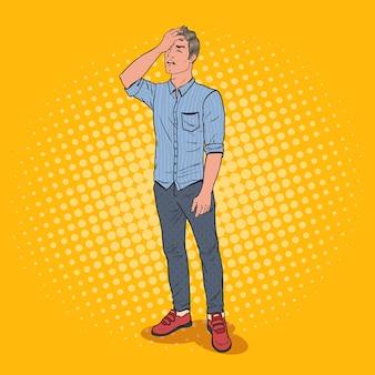 Pop art podkreślił mężczyzna zakrywający twarz ręką