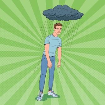 Pop art przygnębiony młody człowiek w deszczu