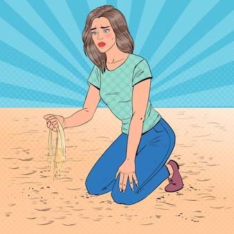 Pop art smutna młoda kobieta siedzi na plaży