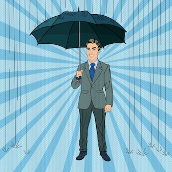 Pop art szczęśliwy biznesmen pod deszczem z parasolem. ilustracja retro