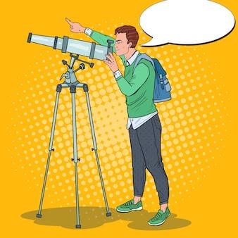 Pop art szczęśliwy człowiek patrząc przez teleskop na niebie