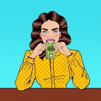 Pop art udane młoda piękna kobieta jedzenie pieniądze.