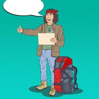 Pop art uśmiechnięty człowiek autostopem hipster z plecakiem.