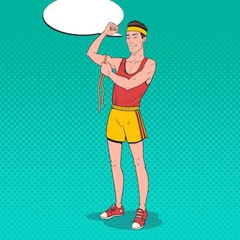 Pop art zabawny sportowiec mierzy swoje mięśnie